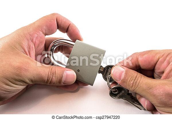 lucchetto, sbloccando, mani - csp27947220