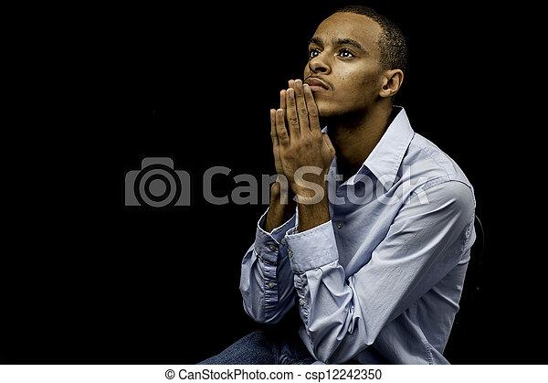 nero, pregare, maschio giovane - csp12242350